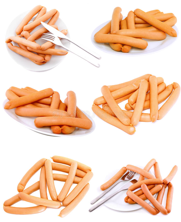 Accumulazione (imposti) della salsiccia fresca sulla zolla. Isolato fotografia stock