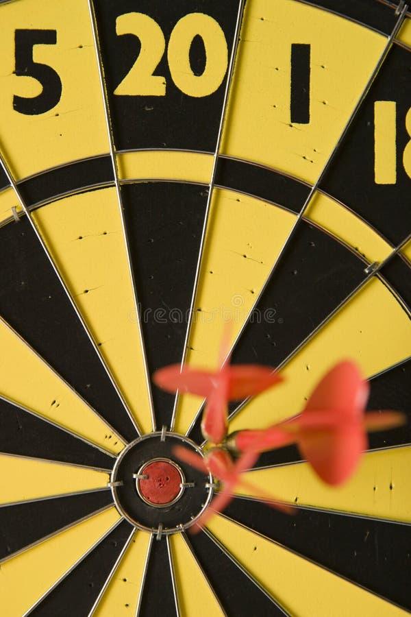 Accuracy. Near bullseye miss on dart board illustrates precision but not accuracy stock photo