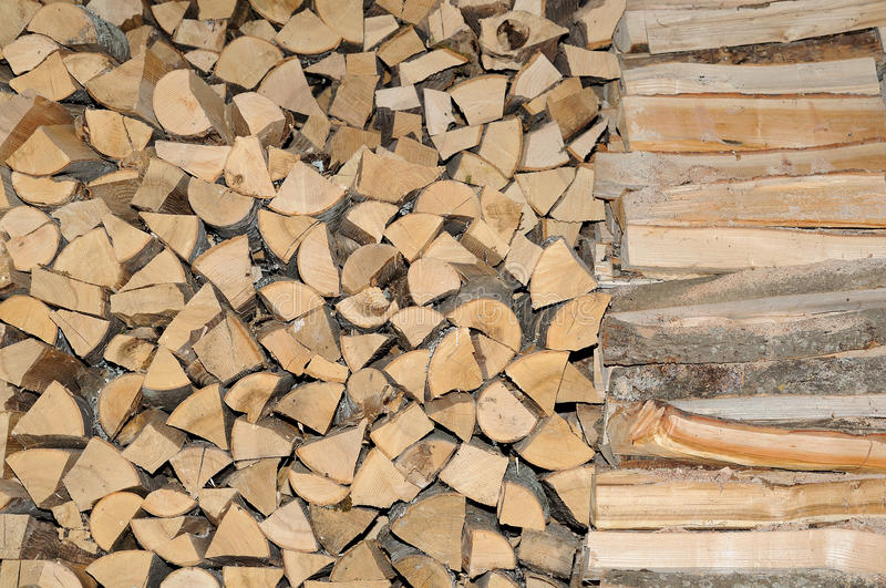 Accurately put firewood. Firewood which is accurately put in a shed royalty free stock photos