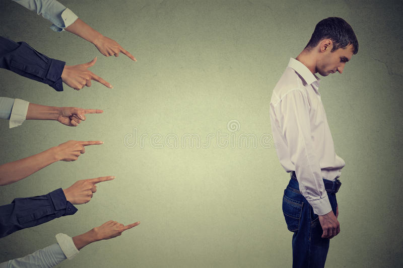 Accusation guilty person guy. Side profile sad upset man looking down many fingers pointing at him. Concept of accusation guilty person guy. Side profile sad royalty free stock image