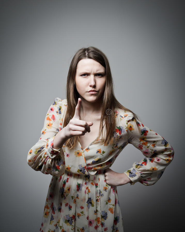 Accusation. Woman is indicating something with aggression stock photo
