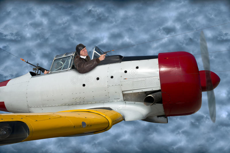 Ace Fighter Pilot Flying Plane in Battle. A fun image of an aviator ace fighter pilot in battle. This man has guts as he is engaged in a dogfight. The male and royalty free stock images