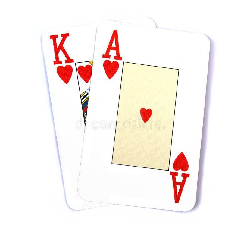 Ace le schede di gioco adatte re, isolate su bianco fotografie stock