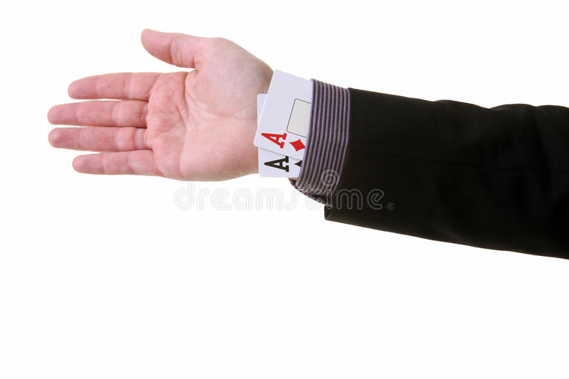 Ace sleeve fraud and cheating. Ace up the sleeve or magic trick. cheating in card game or creating an unfair advantage stock photo