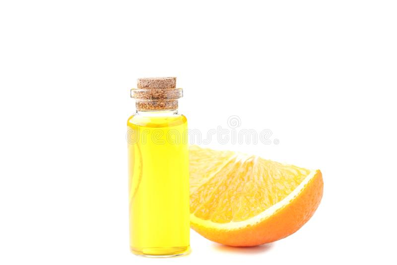 Aceite anaranjado en botella foto de archivo