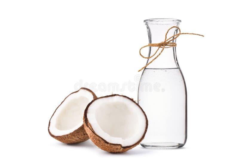 Aceite de coco virginal adicional planchado en frío en botellas imagenes de archivo