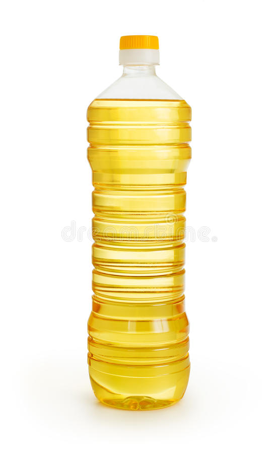Aceite de la verdura o de girasol en botella plástica   imágenes de archivo libres de regalías