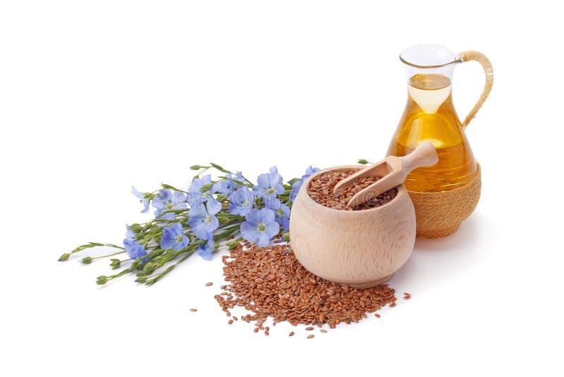 Aceite de linaza con las semillas de lino imagen de archivo libre de regalías
