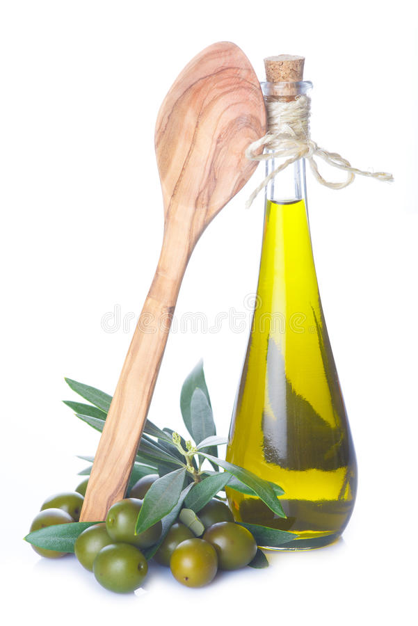 Aceite de oliva aislado en un fondo blanco fotografía de archivo