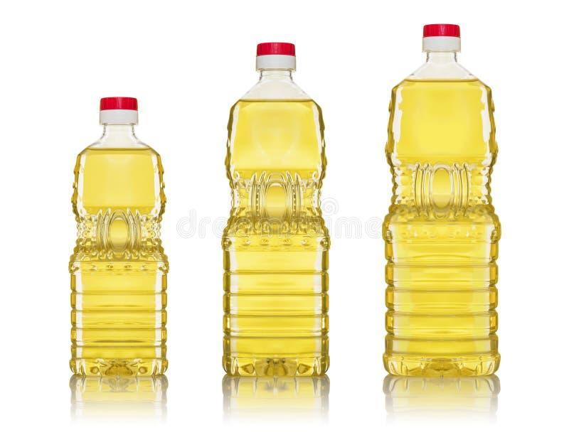 Aceite de oliva y botellas de petróleo de girasol imagen de archivo