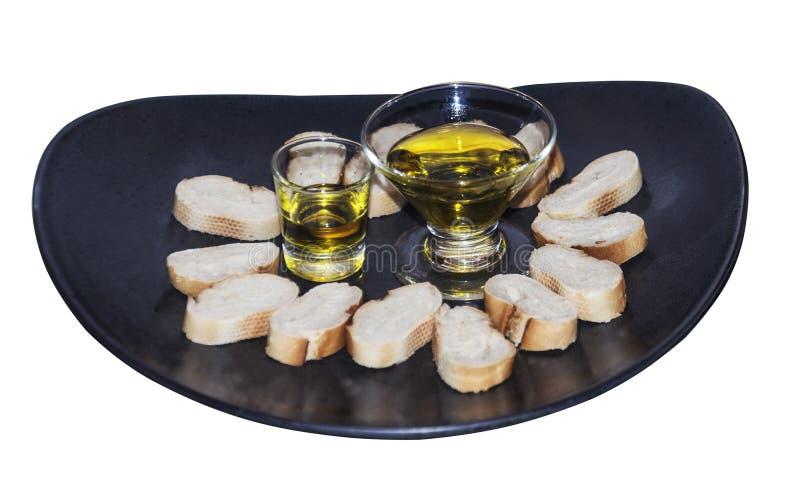 Aceite de oliva y pan blanco del piecesof fotos de archivo