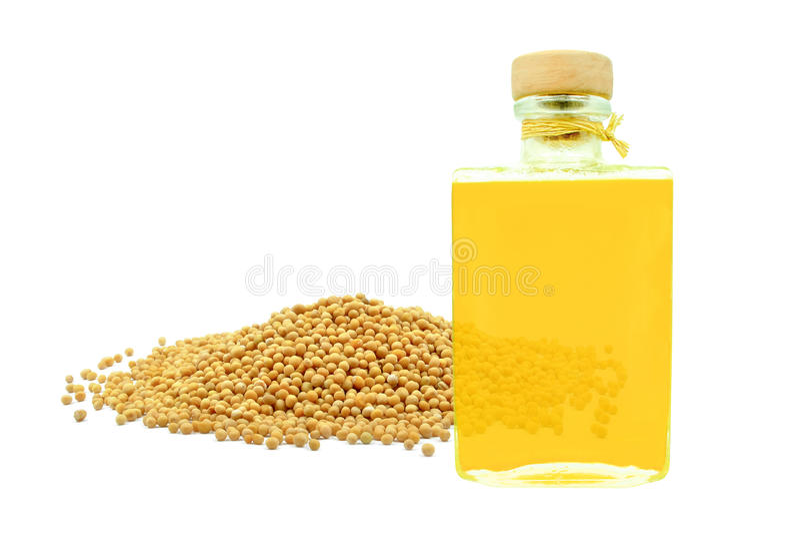 Aceite de semilla de mostaza imagenes de archivo