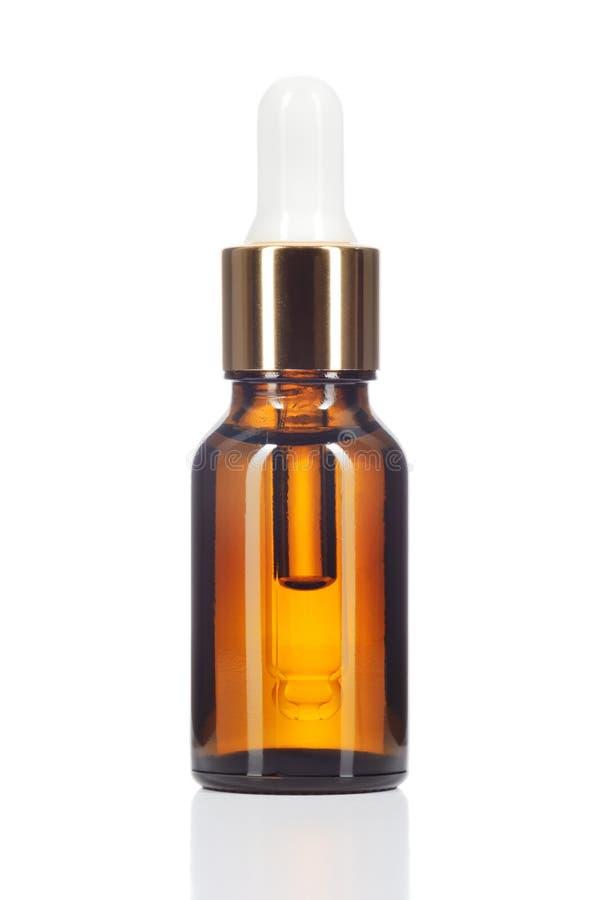 Aceite orgánico natural en el fondo blanco. foto de archivo libre de regalías