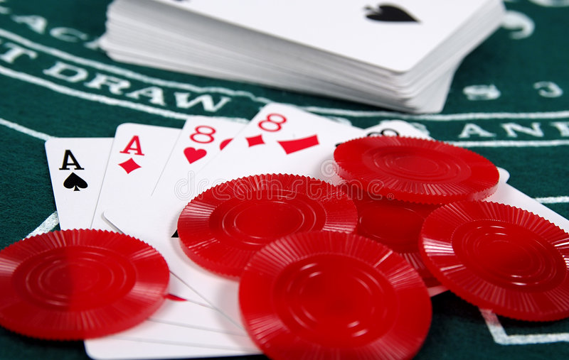 Aces and Eights. Photo of Aces and Eights on a Poker Table With Chips royalty free stock images