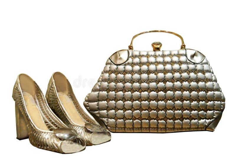 Acessórios de prata, isolado em um fundo branco, saco b do ` s das mulheres foto de stock royalty free