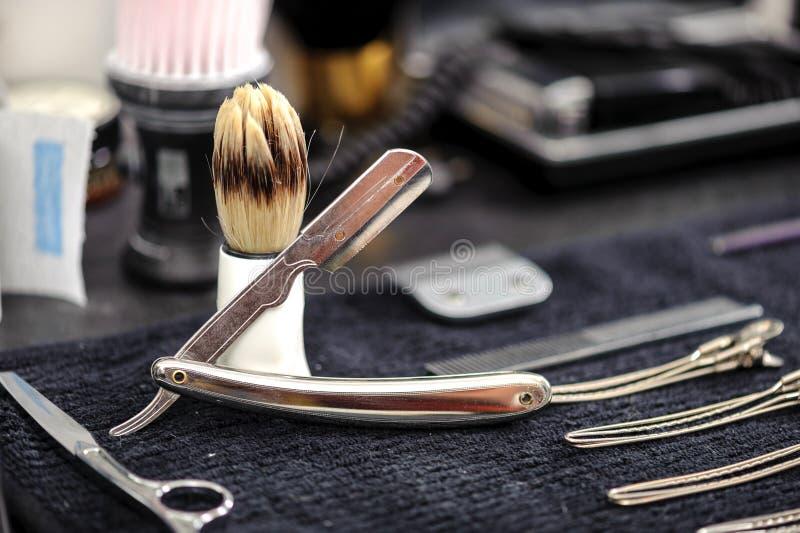 Acessórios e ferramentas do barbeiro imagem de stock