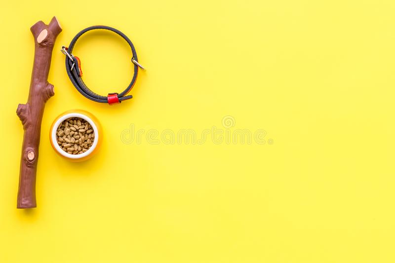 Acessories for the grooming of the dog. Food and toys for dogs. Yellow background top view mock-up royalty free stock photography