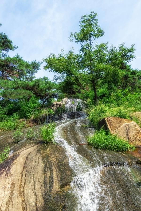 Achasan waterfall in summer. Achasan waterfall with water trickling down the rocks. Taken in Seoul, South Korea stock image