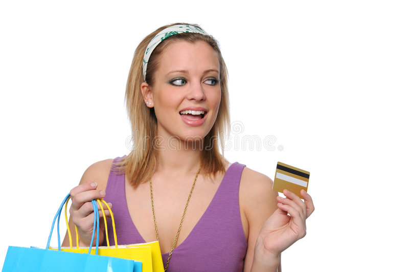 Achats et payind de l'adolescence avec un par la carte de crédit photographie stock