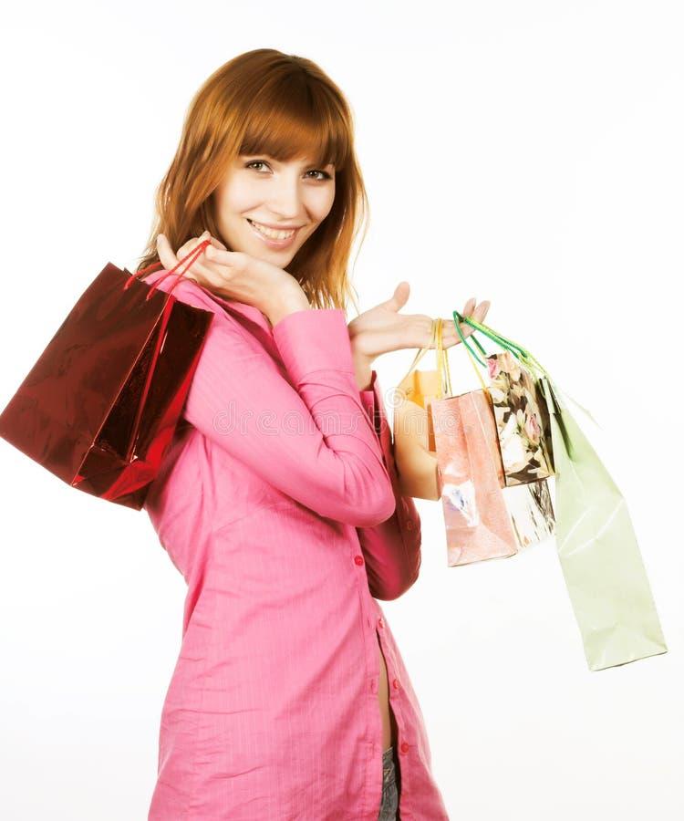 Achats, jeune femme avec des sacs image stock