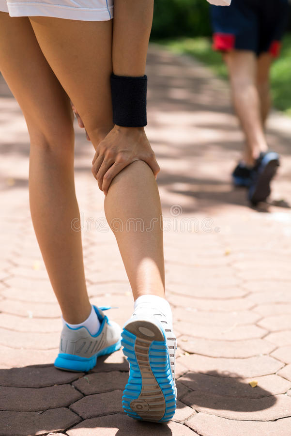 Ache in knee. Cropped image of a sporty person having knee ache stock images