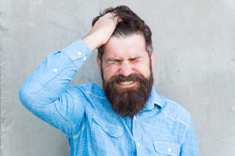 Aches and pains. headache and overworking. negative emotions. feel bad. Bearded man. Mature hipster with beard. male. Facial care. male barber fashion care royalty free stock photography