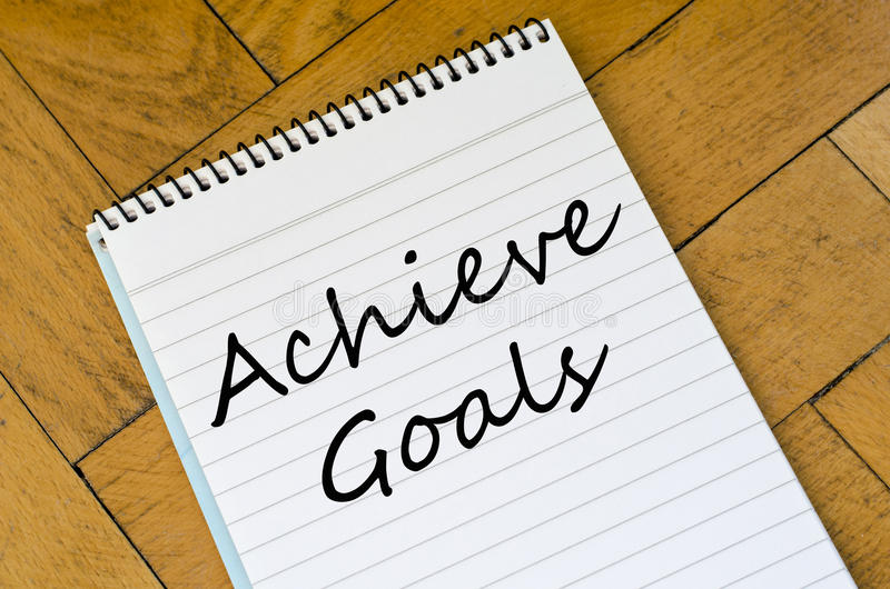 Achieve goals concept on notebook. Achieve goals text concept write on notebook stock photos