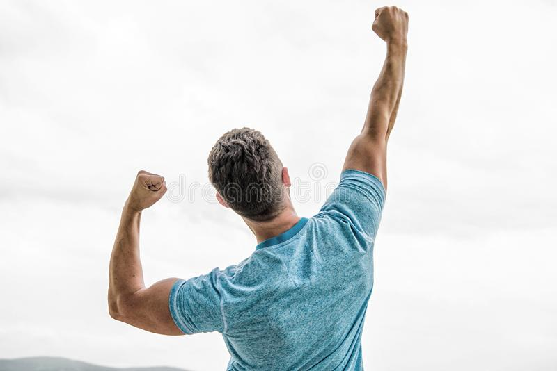 Achieve main goal. muscular back man isolated on white. man look emotional successful celebrate victory. after great stock photos