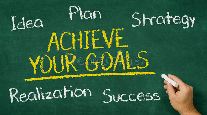 Achieve your goals. Hand writing on a chalkboard - Achieve your goals royalty free stock images