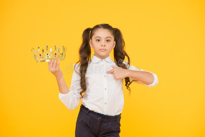 Achievement concept. Adorable small child champion girl. Little winner coronation. Beautiful princess. Just best royalty free stock images