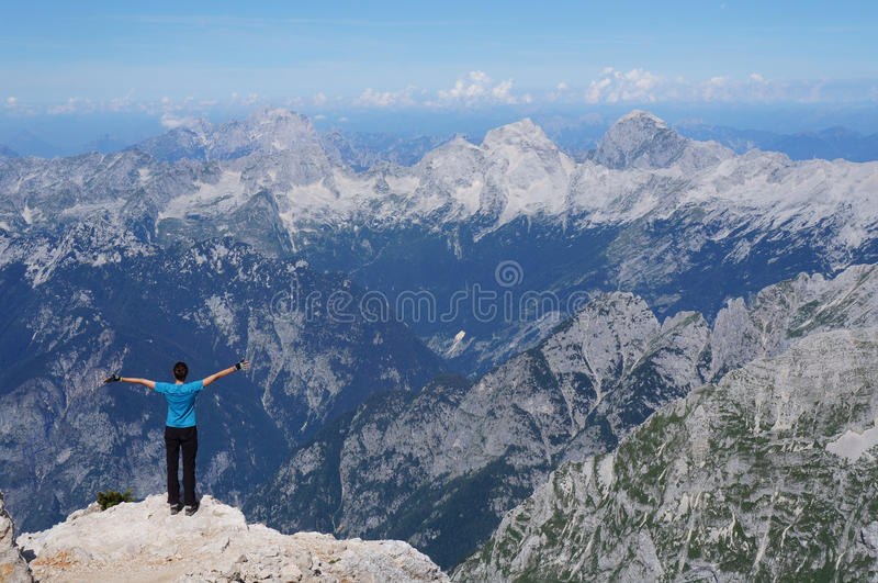Achievement of a happy hiker stock image