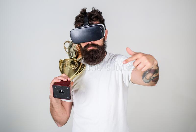 Achievement unlocked. Feel victory in virtual reality games. Achieve victory. Hipster virtual gamer got achievement. Man royalty free stock photos