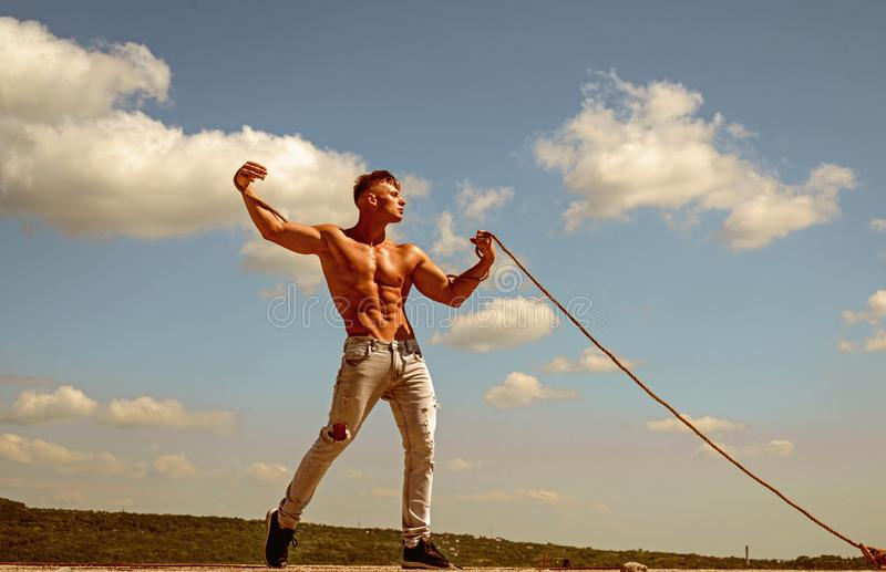 Achieving ambition in sport. Strong man pull rope. Sport man develop muscular hand strength. Athlete with fit torso. Sport exercises for building strength and stock photography