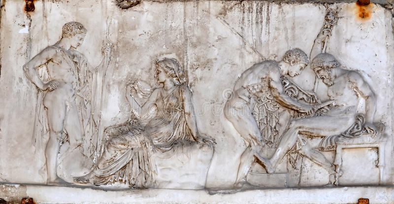Achilles and Telephus. Ancient roman sculpture showing the legend of Achilles and Telephus (son of Hercules). Achilles uses the spear that caused the wound to stock image
