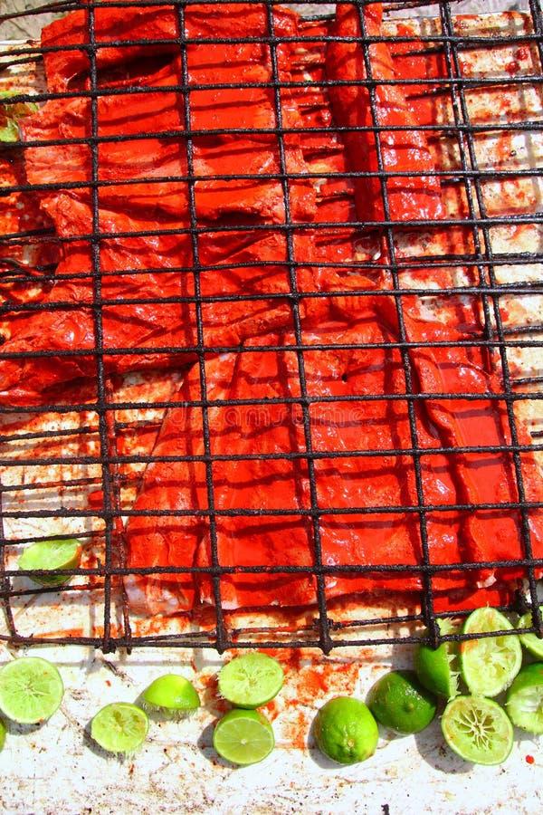 Achiote e filetto di pesce cotto salsa del limone immagini stock libere da diritti