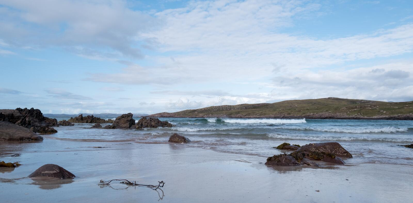 Achnahaird Beach in Wester Ross, Scottish Highlands. Quiet, cresent shaped beach on the north west coast of Scotland. Achnahaird Beach in Wester Ross, Scottish royalty free stock images