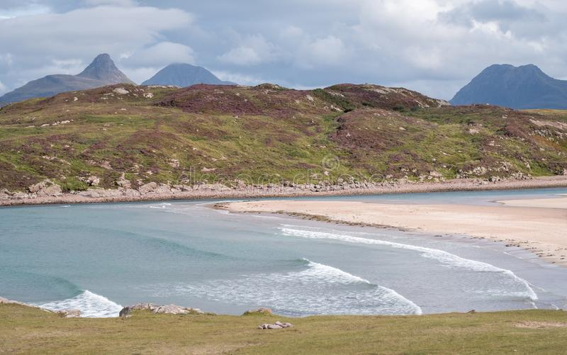 Achnahaird Beach in Wester Ross, Scottish Highlands. Quiet, cresent shaped beach on the north west coast of Scotland. With mountains in the background royalty free stock photo