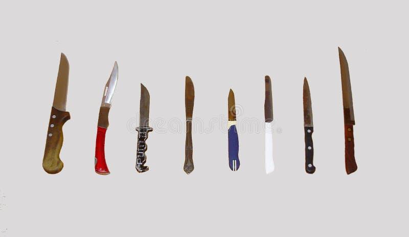 Acht Messer auf einem grauen Hintergrund lizenzfreies stockbild