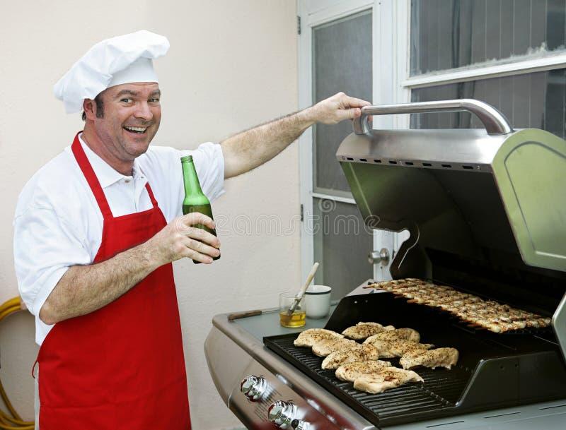 Achter BBQ van de Portiek - Gelukkige Cook stock fotografie