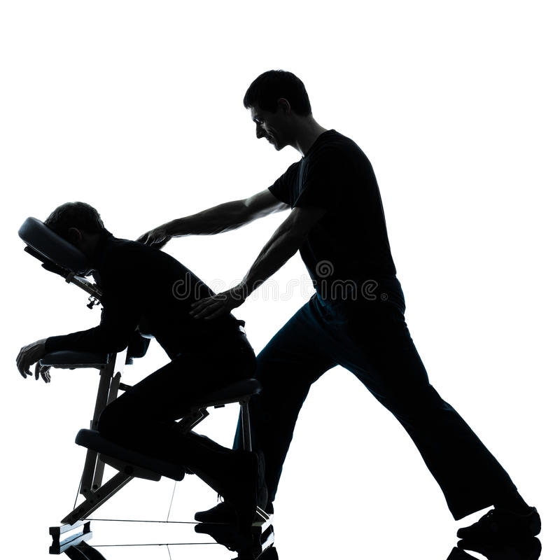 Achter massagetherapie met stoel stock afbeelding