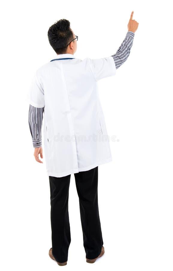 Achter mening van Aziatische medische arts stock foto's