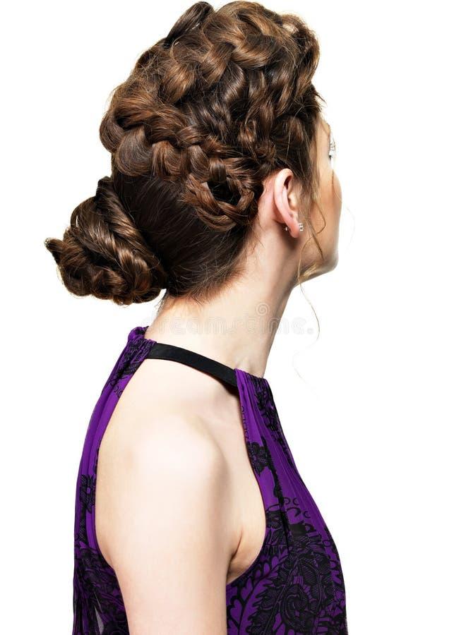 Achter mening van vrouw met creatief kapsel royalty-vrije stock foto's