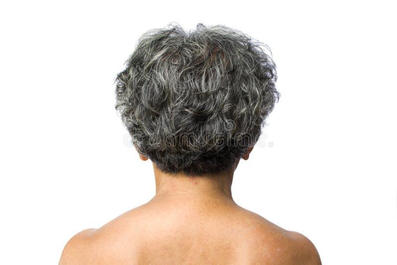 Achter oude vrouw met grijs haar op wit stock afbeeldingen