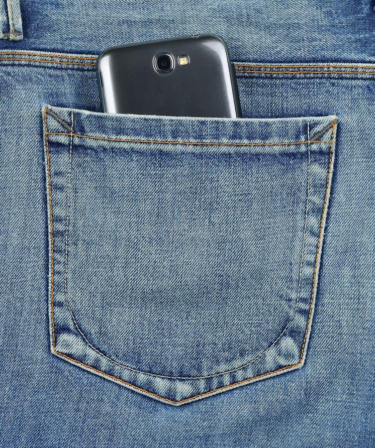 Achter zak van jeans mobiele telefoon royalty-vrije stock foto