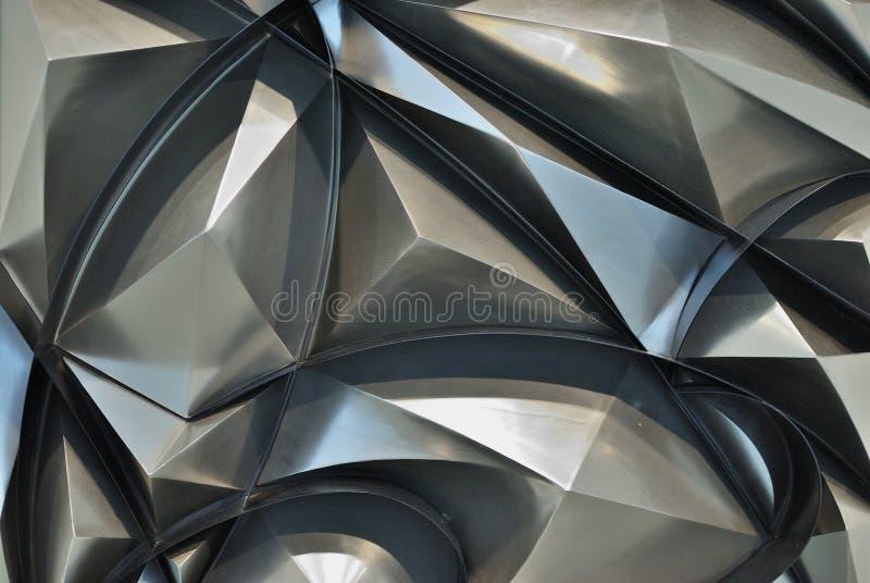 Achtergrond als abstracte die piramides van metaal wordt gemaakt stock afbeelding