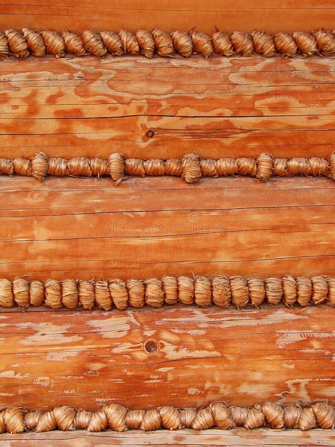 Achtergrond - de buitensporige muur van het logboekhuis stock afbeelding