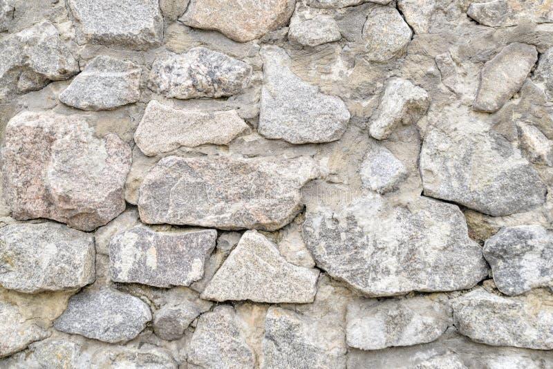 Achtergrond, de muur van de textuursteen over het gehele kader Horizontaal kader stock foto