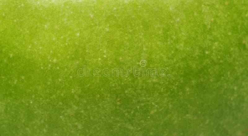 Achtergrond een groene appel royalty-vrije stock afbeelding