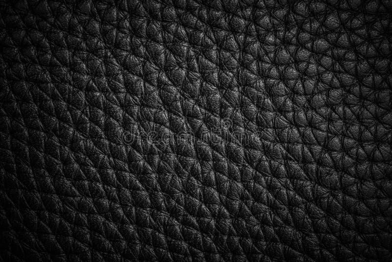 Achtergrond en textuur van echt zwart leerblad royalty-vrije stock afbeeldingen