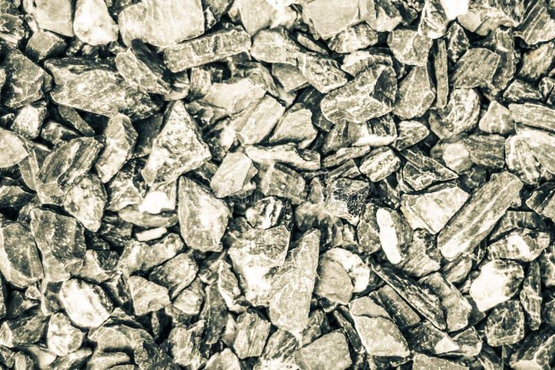 Achtergrond en textuur van Kleine stenenrots Verpletterde grinttextuur, openlucht rustiek sterk gevoel royalty-vrije stock afbeelding